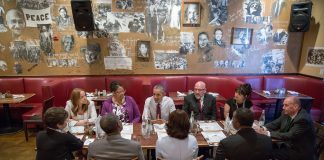 President Obama sitting at table with others (White House)