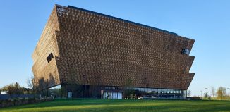 Tiered building at sunset reflecting off black tiles (© Alan Karchmer/Smithsonian Institution)