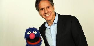 Grover the Muppet (left) and Antony Blinken (State Dept.)