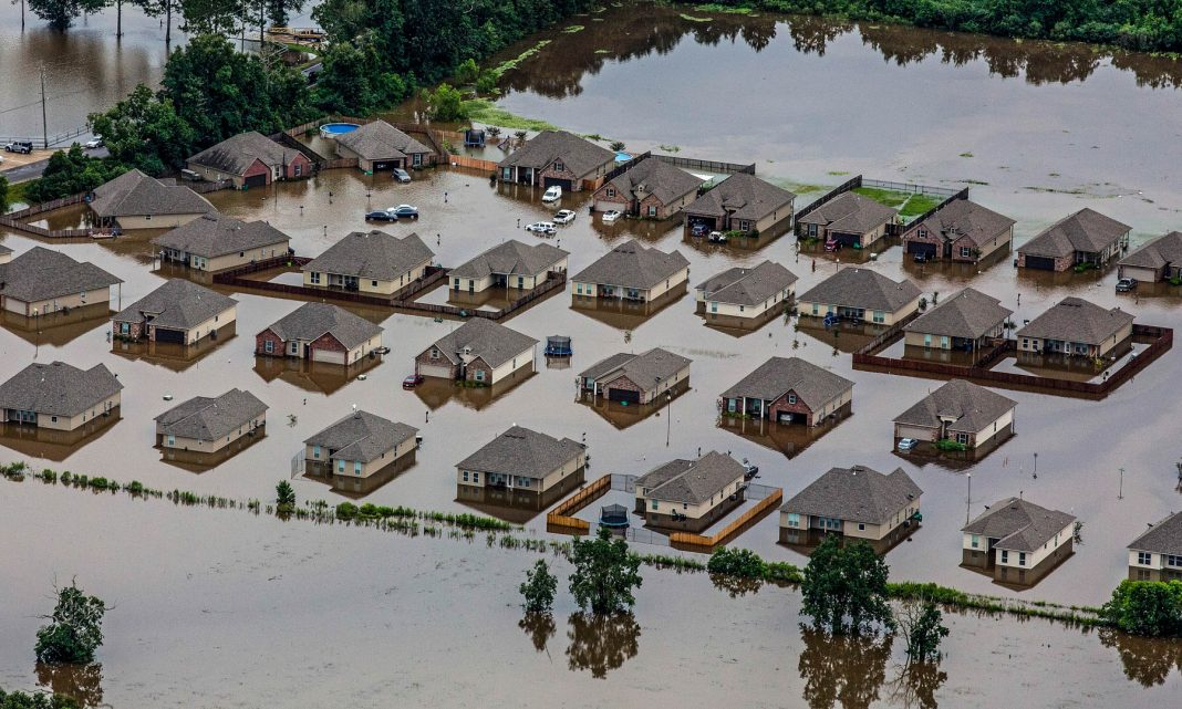Aerial view of partially submerged houses (© AP Images)