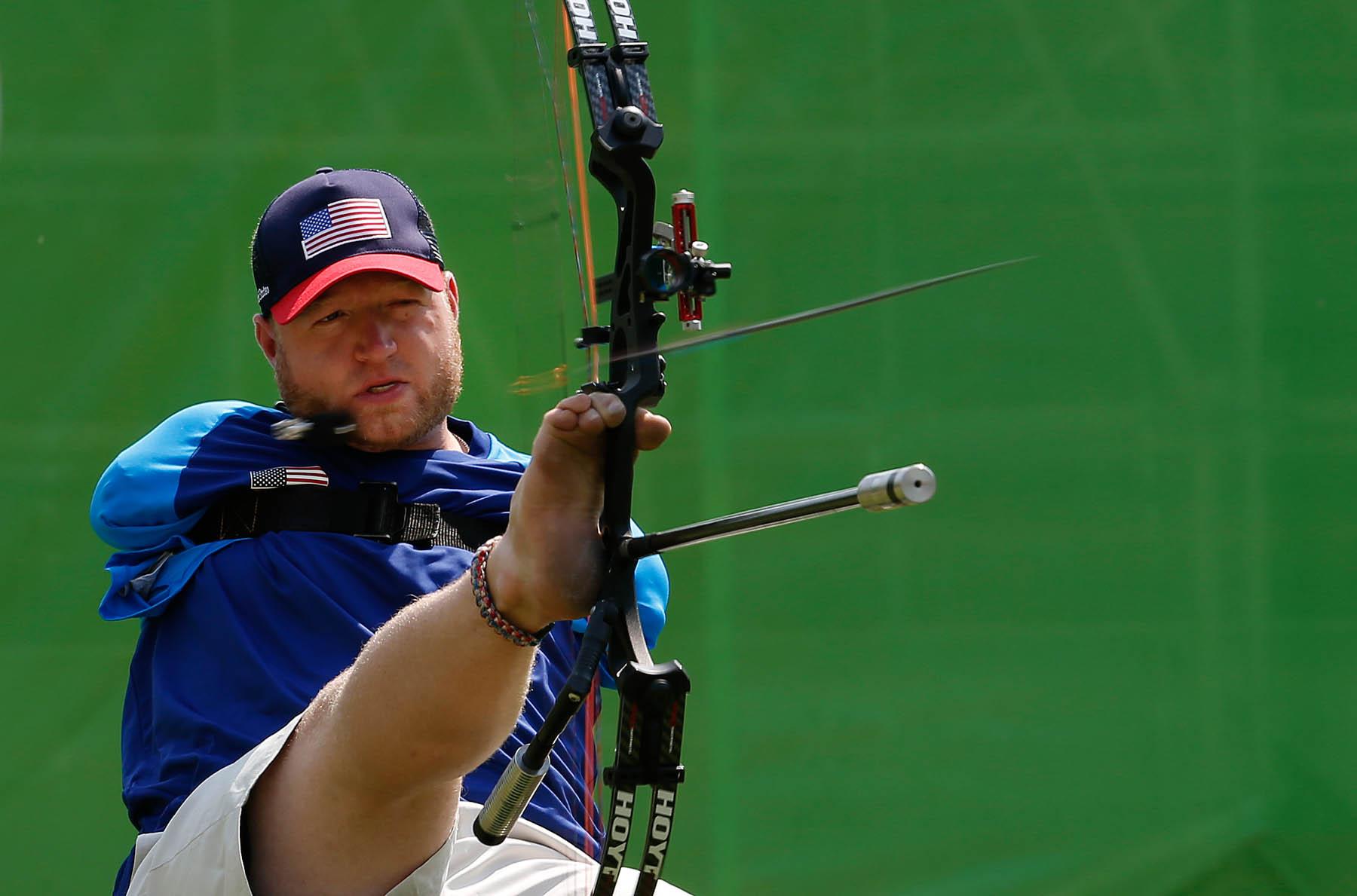 Archer shooting arrow using his legs (© AP Images)