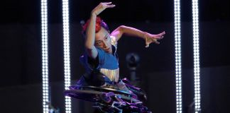 Dancer performing on top of overturned wheelchair (© AP Images)