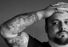 Man with tattooed arm (Mark Seliger)