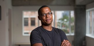 Playwright Branden Jacobs-Jenkins standing, with arms folded (John D. and Catherine T. MacArthur Foundation)