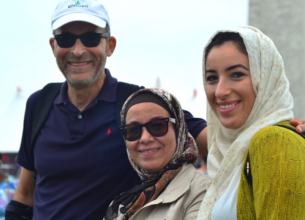 Three people standing near Washington Monument (State Dept./M. Buchanan)
