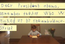 Video of boy reading letter at table (The White House/YouTube)