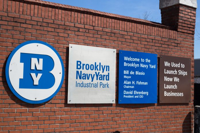 Brooklyn Navy Yard with signs posted on exterior brick wall (© littleny / Shutterstock)
