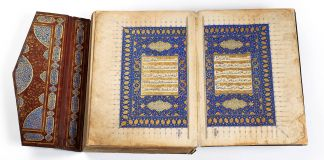 Open book with blue artwork and decorated cover (Courtesy of Istanbul Museum of Turkish and Islamic Arts)