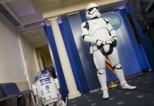 Star Wars' R2-D2 and a stormtrooper standing in the White House (© AP Images)