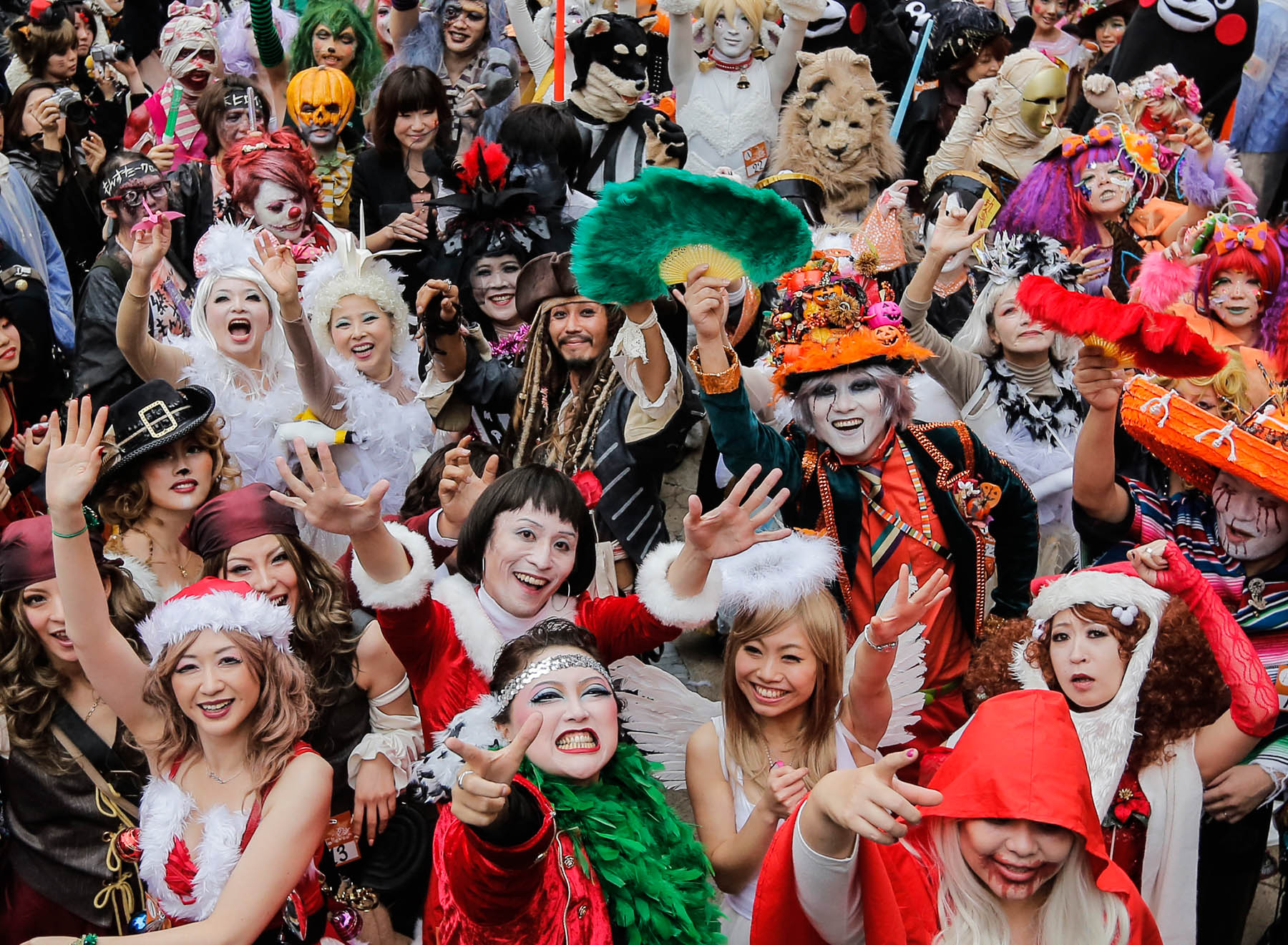 Crowd of costumed people celebrating (© AP Images)