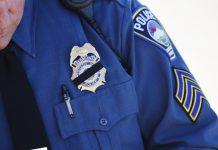 Police officer in uniform (© AP Images)