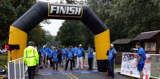 Runners crossing the finish line of a race (Courtesy of Ahmadiyya Muslim Youth Association/Waleed Ahmad Khan)