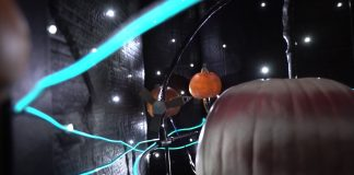 Model spacecraft orbiting carved pumpkin planet (NASA/JPL-Caltech)