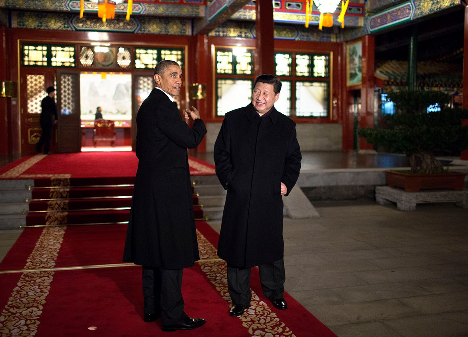 President Obama and Xi Jinping standing in room with red carpet and Chinese decorations (White House/Pete Souza)