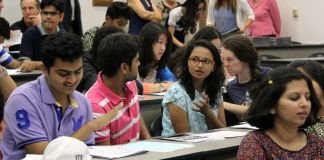 Students talking among themselves in classroom (Courtesy of Nikita Ankem)