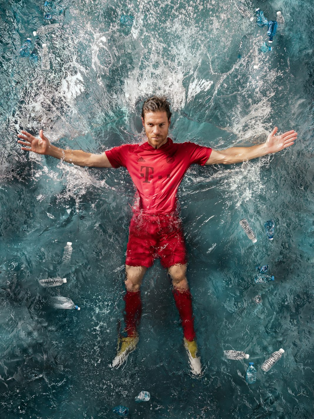 Man wearing soccer uniform falling backward into water (Courtesy of Adidas)