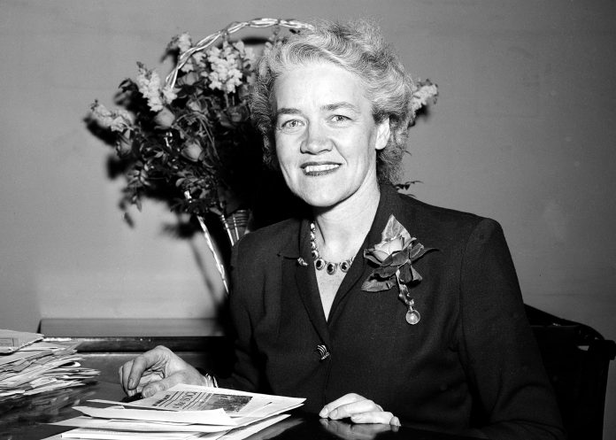 Margaret Chase Smith, seated and smiling (© AP Images)
