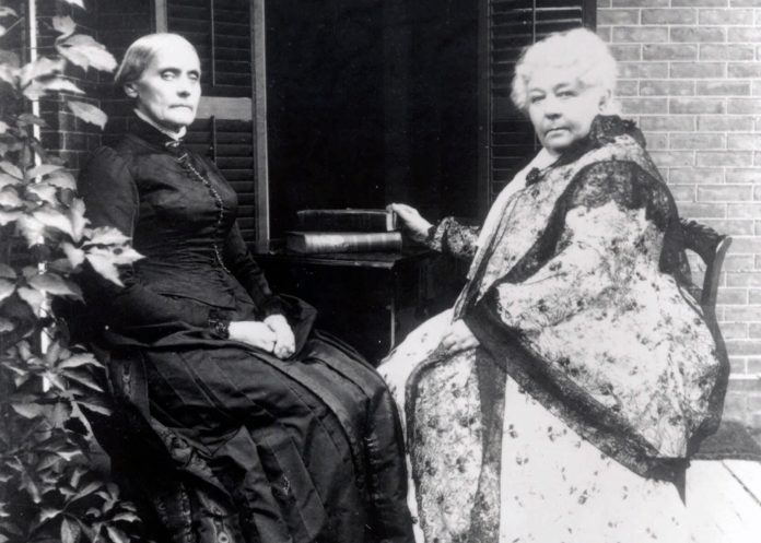 Susan B. Anthony and Elizabeth Cady Stanton seated outdoors, facing camera (© AP Images)