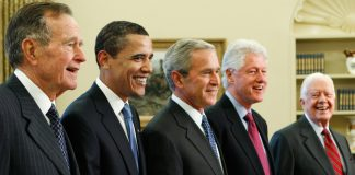 George H.W. Bush, Barack Obama, George W. Bush, Bill Clinton and Jimmy Carter standing together (© AP Images)