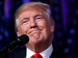 Close-up of Donald Trump in front of microphone (© AP Images)