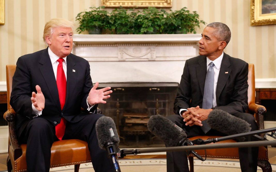 Donald Trump and President Obama sitting together (© AP Images)