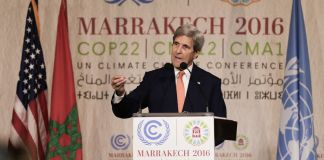 Secretary of State John Kerry speaking at podium (© AP Images)