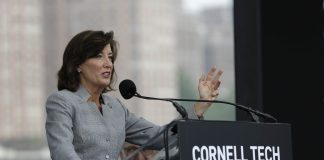 Kathy Hochul at lectern ((© AP Images)