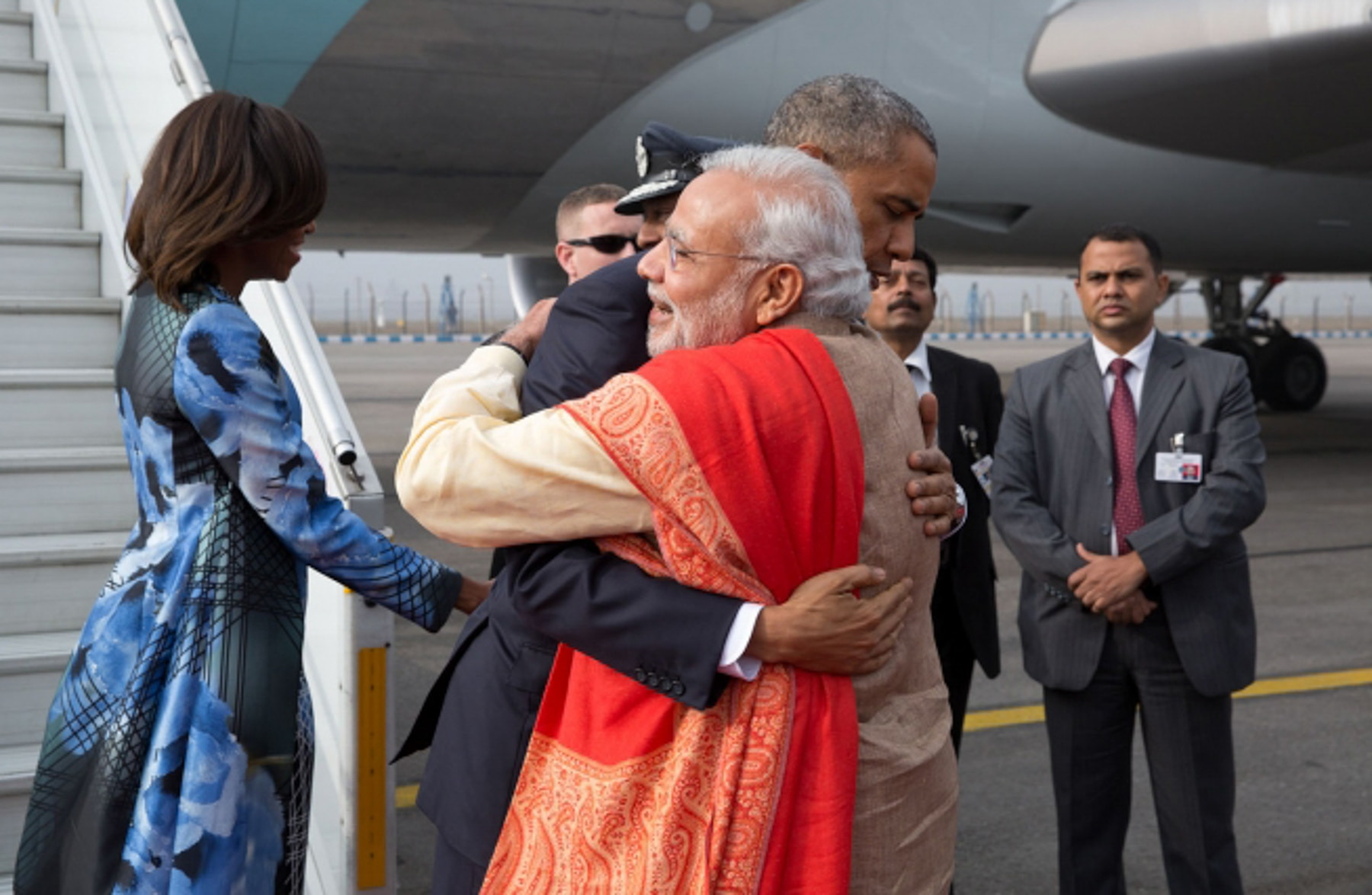 President Obama and Narendra Modi hugging at base of aircraft stairs (White House/Pete Souza)