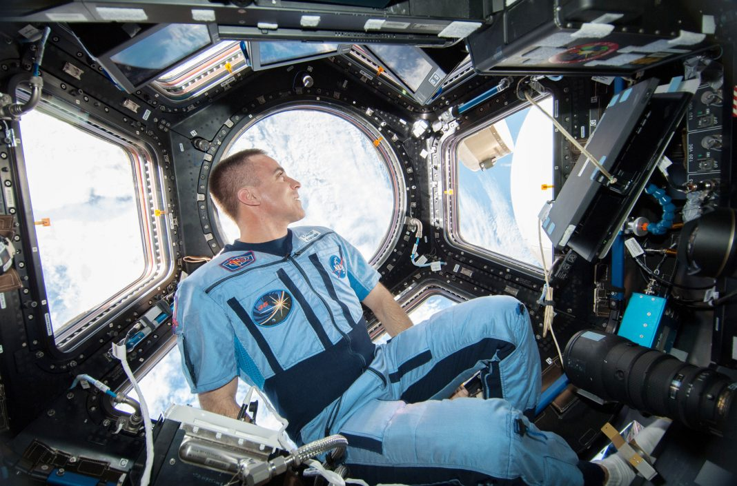 Chris Cassidy in International Space Station; view of Earth through windows (NASA)