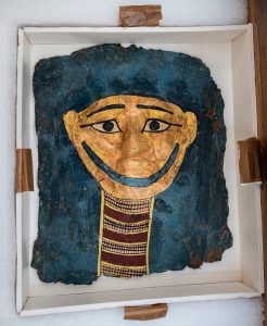 Box containing painted Egyptian mask (Immigration and Customs Enforcement)