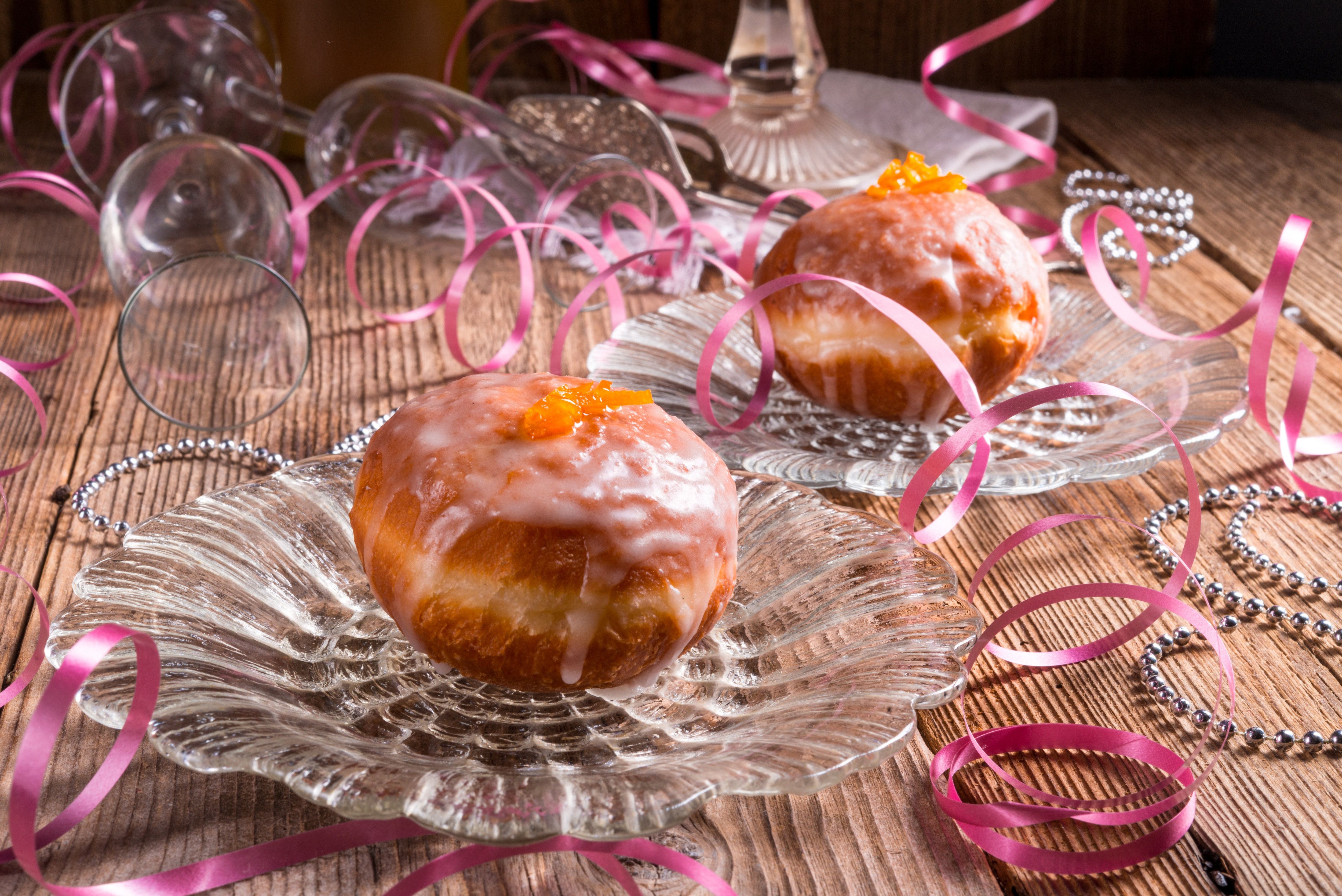 Jelly doughnuts with ribbons around them (Shutterstock)