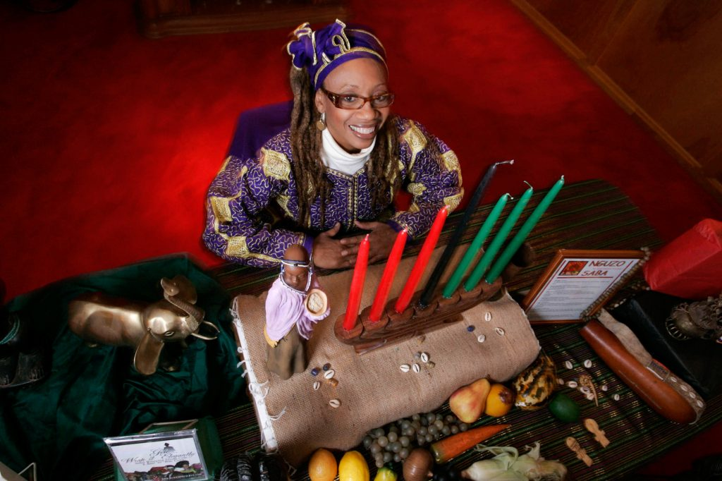 Woman in African garb with Kwanzaa candles (© AP Images)