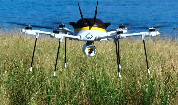 Drone landing in grassy area (© AP Images)