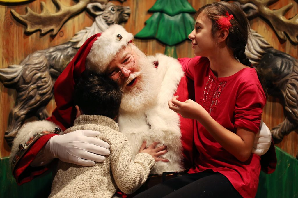 Children visiting Santa Claus (© AP Images)