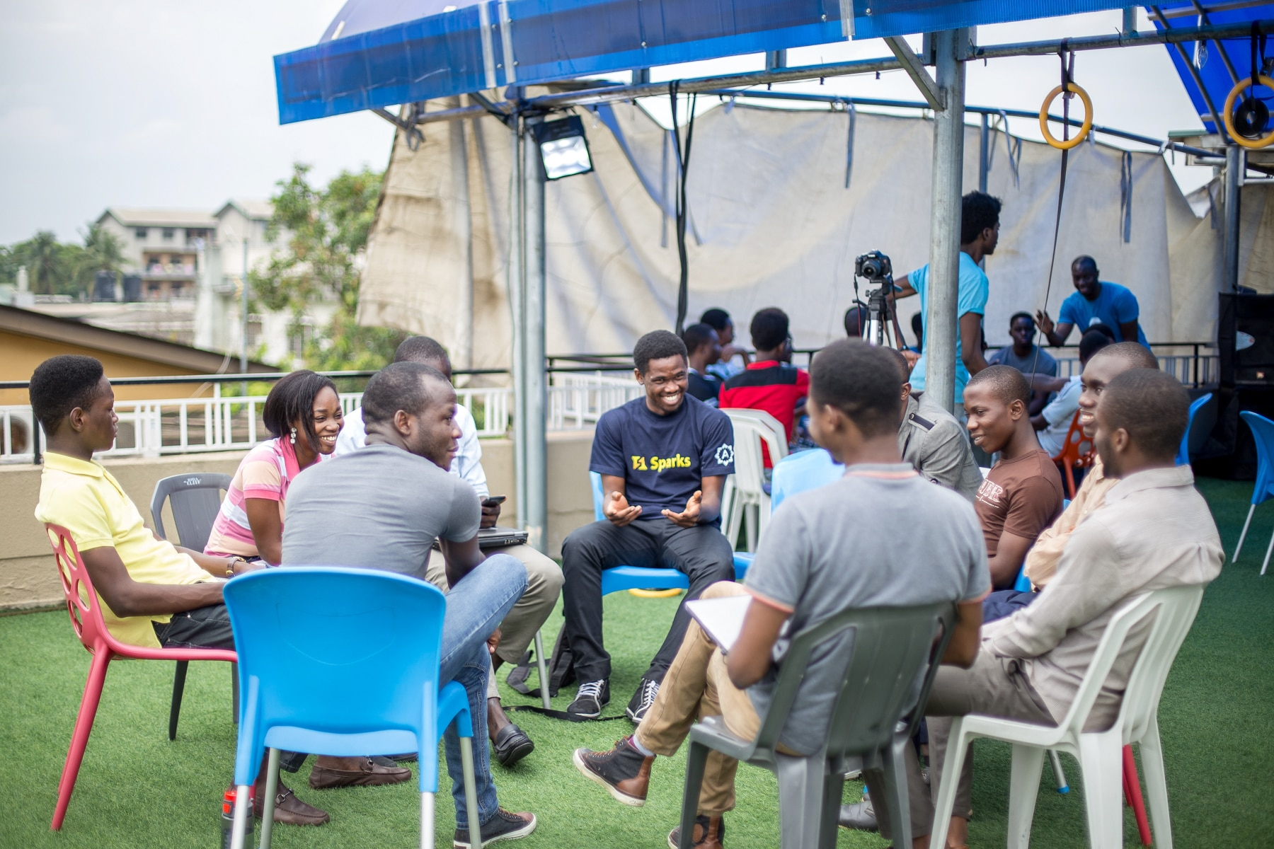 Group of people sitting in chairs in circle (Courtesy of Andela)