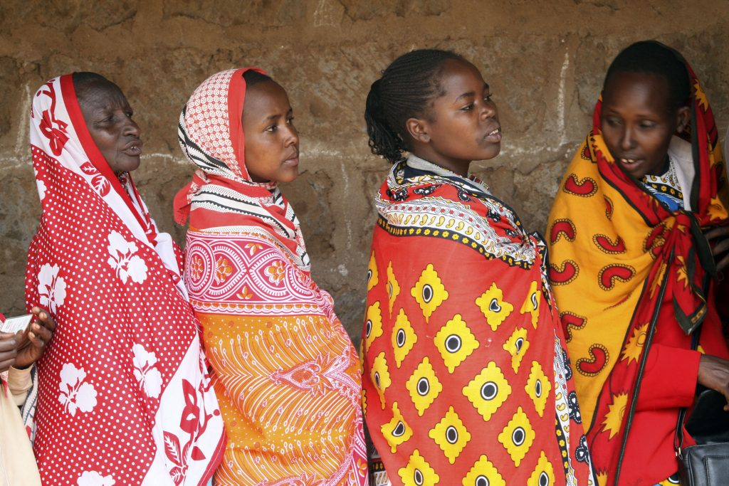 Four African women wearing colorful cloth (© AP Images)