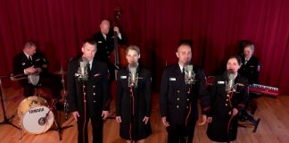 Uniformed musicians on stage (U.S. Navy via YouTube)