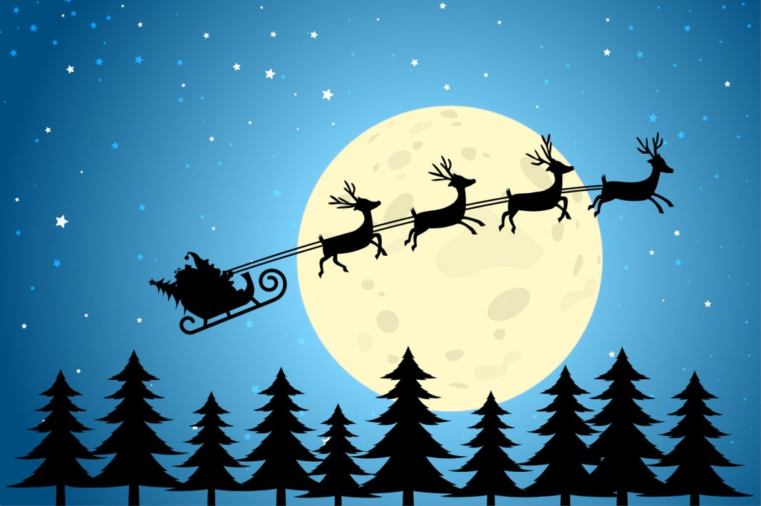 Cartoon image of Santa riding in sleigh with reindeer in front of moon (Shutterstock)