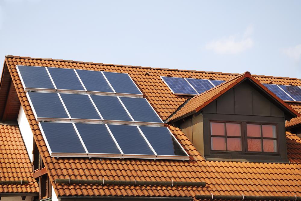 Solar panels on terracotta tile roof (© Shutterstock)