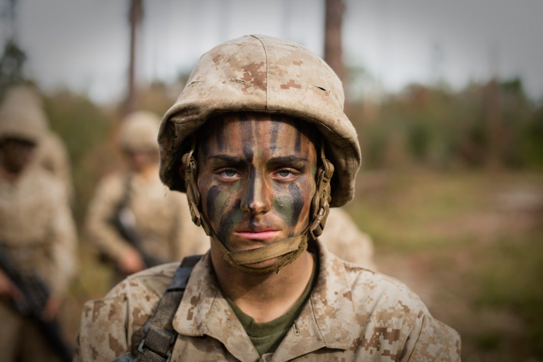Maria Daume wearing camouflage makeup and military uniform (U.S. Marine Corps/Staff Sergeant Greg Thomas)