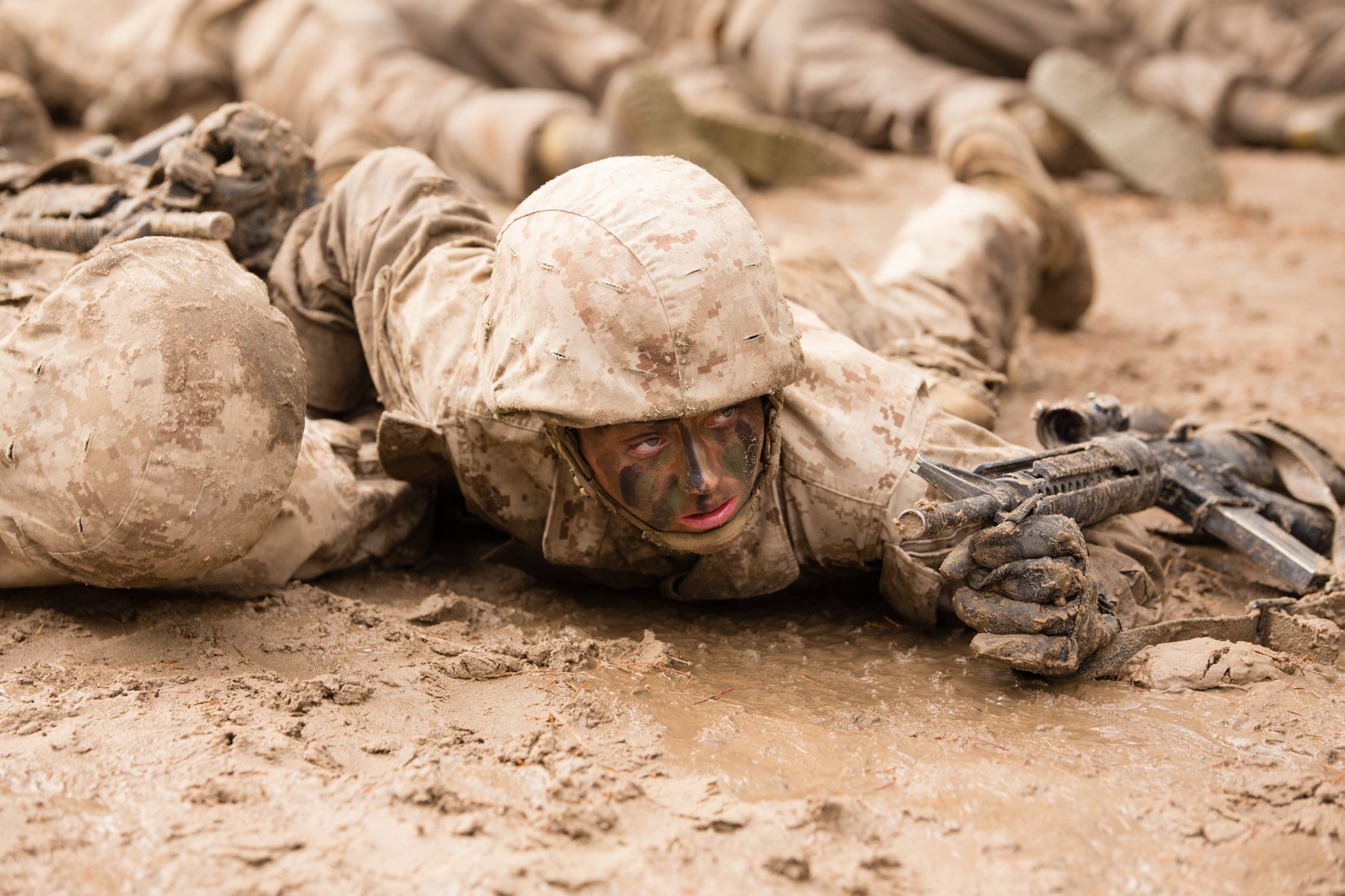 Soldier lying facedown in mud (U.S. Marine Corps/Staff Sergeant Greg Thomas)