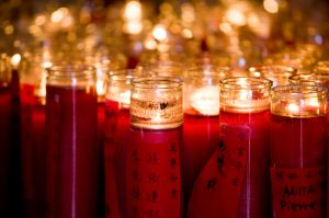 Red candles burning (© AP Images)
