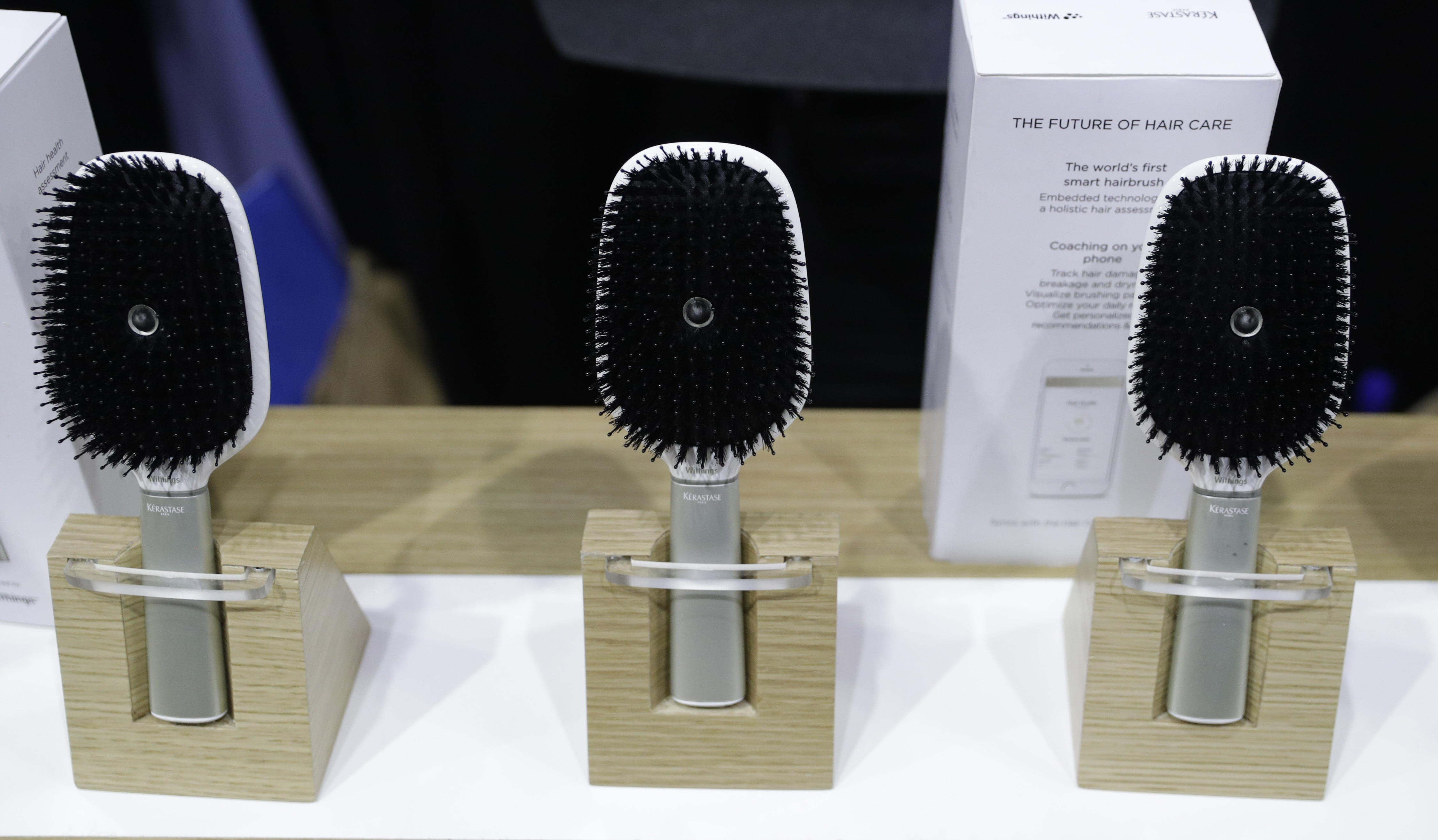 Three hairbrushes on display (© AP Images)