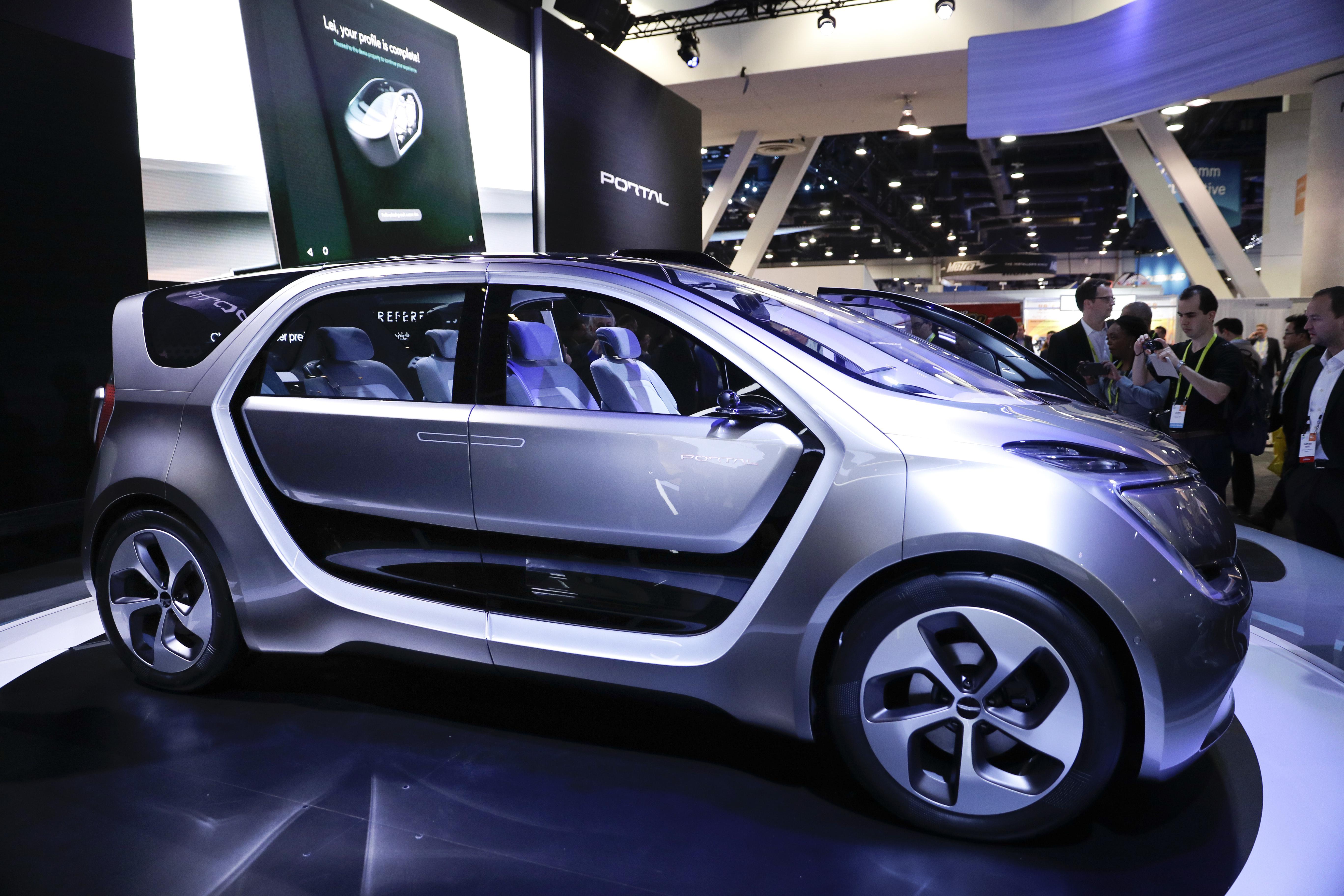 Futuristic car on display (© AP Images)