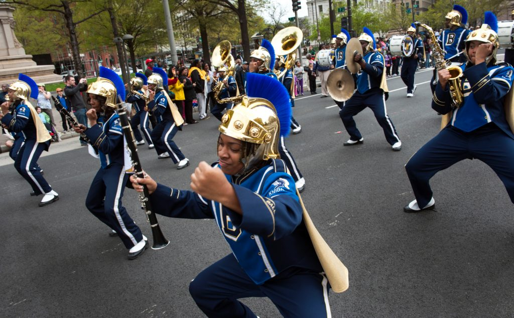 Band marching down street in parade (© Getty Images/Katherine Frey/The Washington Post)