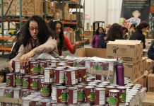Volunteers handling canned food (Corporation for National and Community Service)