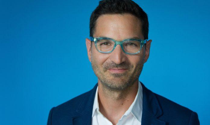 Man with blue glasses (© Kara Frame/NPR)