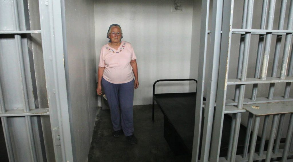 Woman standing in jail cell (Joan Trumpauer Mulholland Foundation)