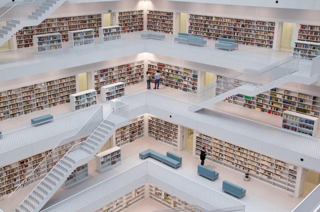 Books on shelves in multi-level library (Shutterstock)