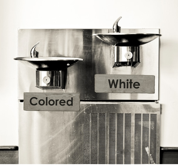 "Water fountains labeled ""Colored"" and ""White"" (Shutterstock)"